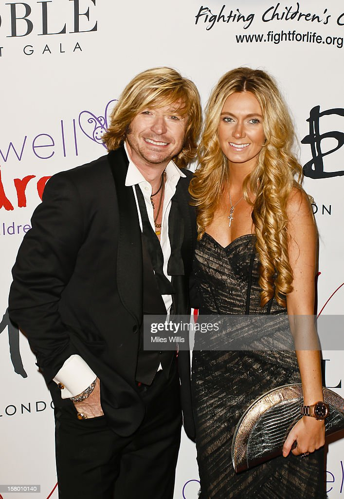 Hairdresser <a gi-track='captionPersonalityLinkClicked' href=/galleries/search?phrase=Nicky+Clarke+-+Hairdresser&family=editorial&specificpeople=224837 ng-click='$event.stopPropagation()'>Nicky Clarke</a> and Kelly Simpkin arrive at the Noble Gift Gala held at the ME Hotel on December 8, 2012 in London, England.