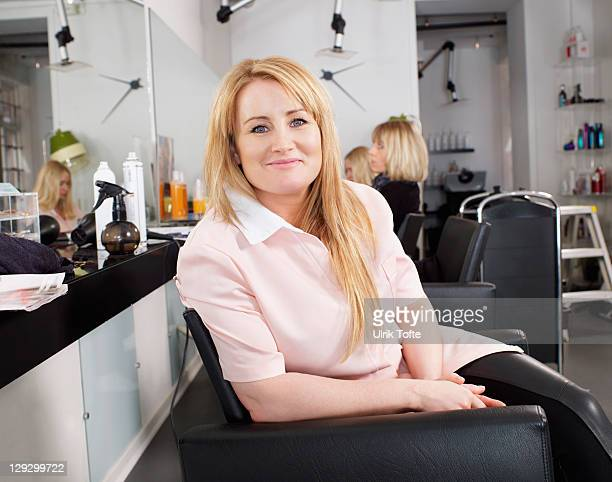 Hairdresser sitting in salon chair