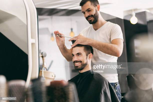 Hairdresser smiling with customer