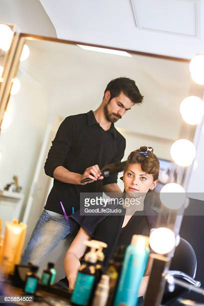Hairdresser styling a fashion model