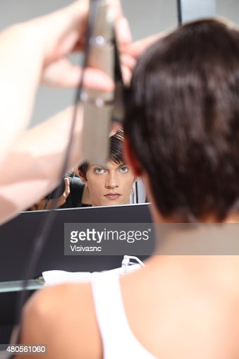 hairdresser to work with man in the mirror : Stock Photo