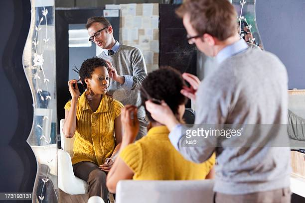 Hairdresser with client in beauty salon