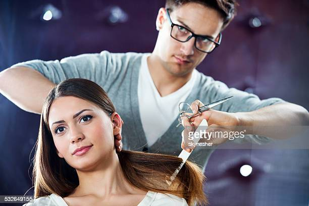 Hairdresser with his customer.