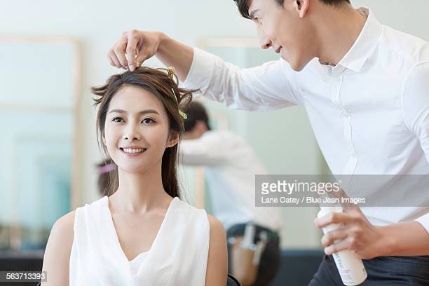 Hairdresser working on customer