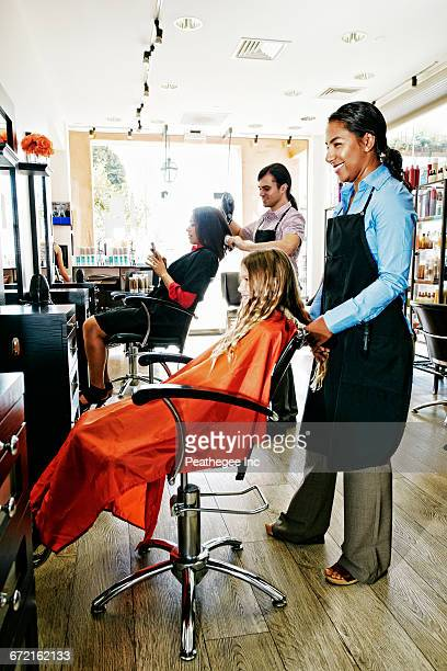 Hairdressers and customers in hair salon