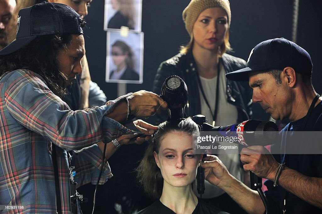 Hairdressers dress the hair of a model backstage prior tot the Sonia Rykiel Fall/Winter 2013 Ready-to-Wear show as part of Paris Fashion Week at Halle Freyssinet on March 1, 2013 in Paris, France.