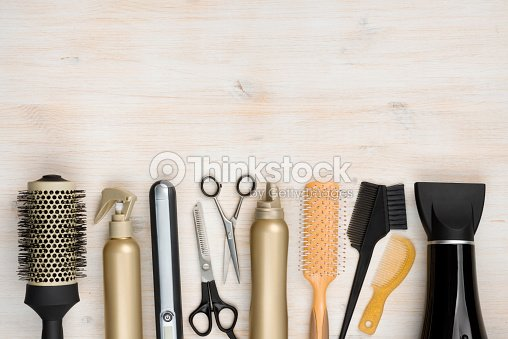 Hairdressing tools on wooden background with copy space at top : Stock Photo