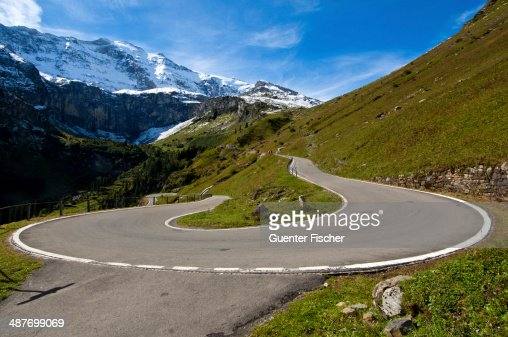 Hairpin curve, mountain road to the Klausen Pass in front of the Glarus Alps, Urnerboden, Canton of Uri, Switzerland