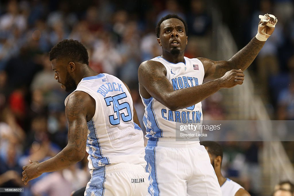 P.J. Hairston #15 and Reggie Bullock #35 of the North Carolina Tar Heels celebrate in the second half while taking on the Maryland Terrapins during the men's ACC Tournament semifinals at Greensboro Coliseum on March 16, 2013 in Greensboro, North Carolina.