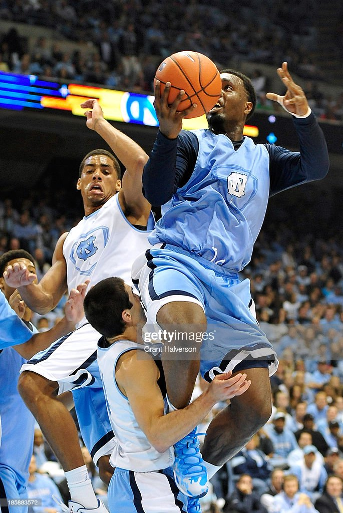 P.J. Hairston #15 collides with teammate Luke Davis #4 of the North Carolina Tar Heels as he drives to the basket during Late Night with Roy Williams at the Dean Smith Center on October 25, 2013 in Chapel Hill, North Carolina.