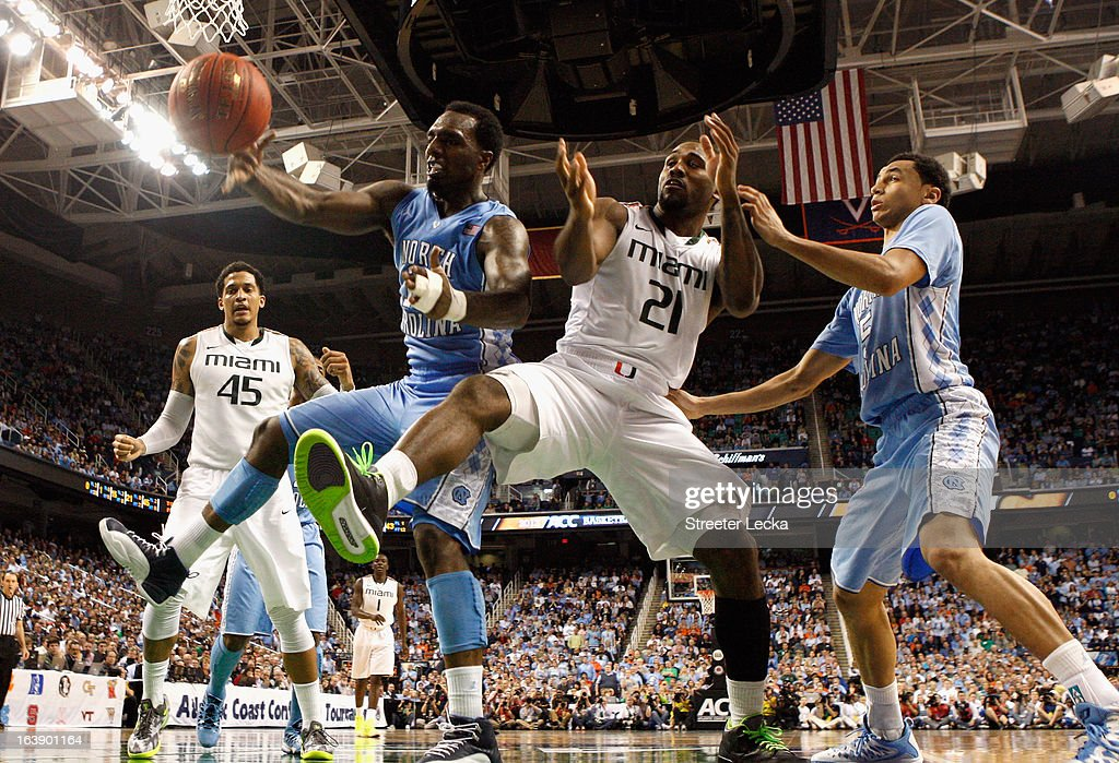 P.J. Hairston #15 of the North Carolina Tar Heels and Erik Swoope #21 of the Miami Hurricanes battle for a loose ball during the finals of the Men's ACC Basketball Tournament at Greensboro Coliseum on March 17, 2013 in Greensboro, North Carolina.