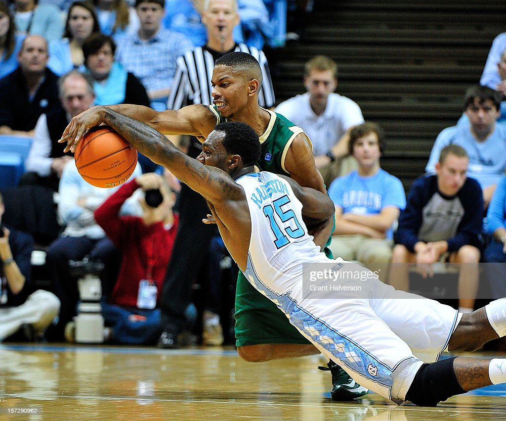 P.J. Hairston #15 of the North Carolina Tar Heels battles for a loose ball against Terence Jones #3 of the UAB Blazers during play at the Dean Smith Center on December 1, 2012 in Chapel Hill, North Carolina. North Carolina won 102-84.