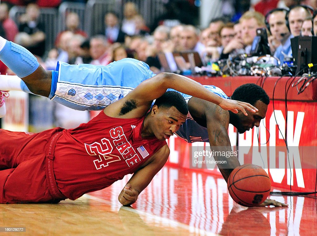P.J. Hairston #15 of the North Carolina Tar Heels battles for a loose ball with T.J. Warren #24 of the North Carolina State Wolfpack during play at PNC Arena on January 26, 2013 in Raleigh, North Carolina. North Carolina State won 91-83.