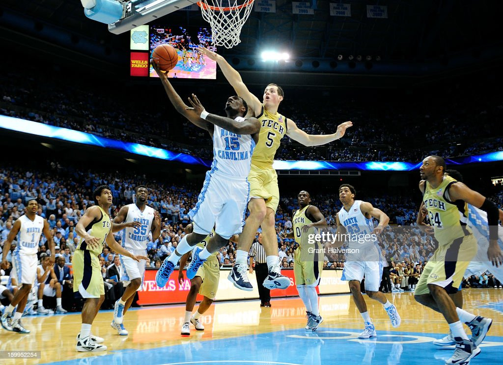 P.J. Hairston #15 of the North Carolina Tar Heels drives against Daniel Miller #5 of the Georgia Tech Yellow Jackets during play at the Dean Smith Center on January 23, 2013 in Chapel Hill, North Carolina. North Carolina won 79-63.