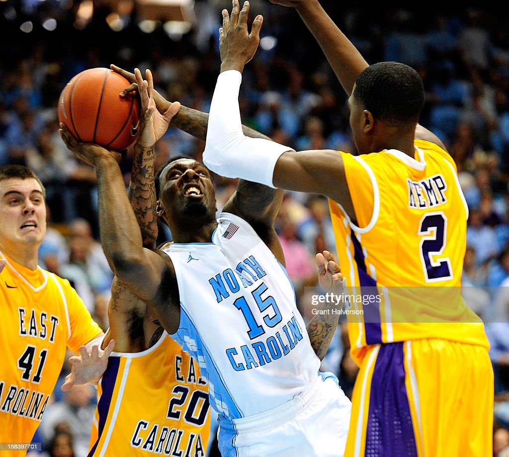 P.J. Hairston #15 of the North Carolina Tar Heels forces up a shot between Marshall Guilmette #41, Shamarr Bowden #20 and Maurice Kemp #2 of the East Carolina Pirates during play at the Dean Smith Center on December 15, 2012 in Chapel Hill, North Carolina. North Carolina won 93-87.