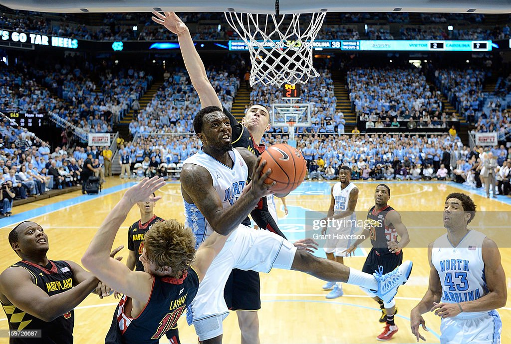 P.J. Hairston #15 of the North Carolina Tar Heels pulls down a rebound over Jake Layman #10 of the Maryland Terrapins during play at the Dean Smith Center on January 19, 2013 in Chapel Hill, North Carolina. North Carolina won 62-52.