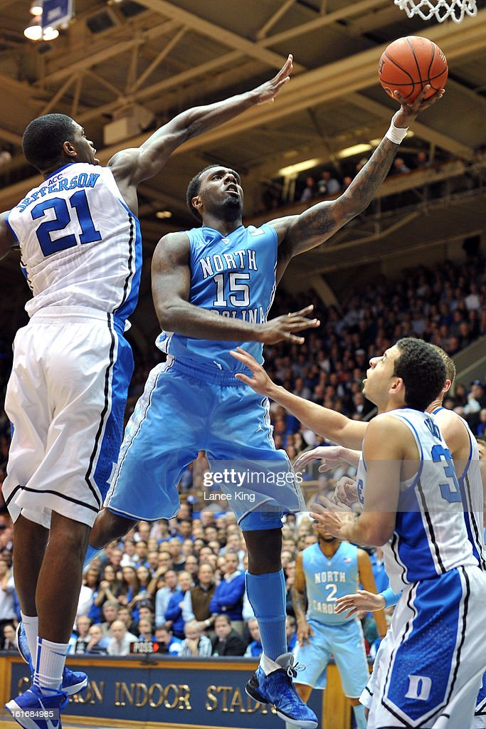 P.J. Hairston #15 of the North Carolina Tar Heels puts up a shot against Amile Jefferson #21 of the Duke Blue Devils at Cameron Indoor Stadium on February 13, 2013 in Durham, North Carolina. Duke defeated North Carolina 73-68.