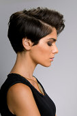 Fashion model with straight short hair profile view.