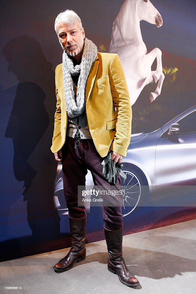 Hairstylist Frank Bohn wearing Prada jacket, Jack&Jones trouser attends Mercedes-Benz Fashion Week Autumn/Winter 2013/14 at the Brandenburg Gate on January 18, 2013 in Berlin, Germany.