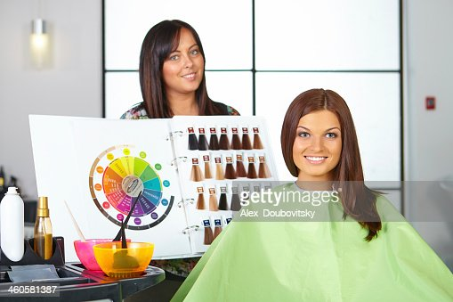 Hairstylist Holding A Board With Dye Color Options In Salon Stock