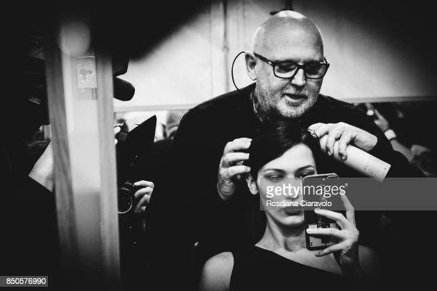 Hairstylist Sam McKnight and Model Bella Hadid are seen backstage ahead of the Max Mara show during Milan Fashion Week Spring/Summer 2018on September...