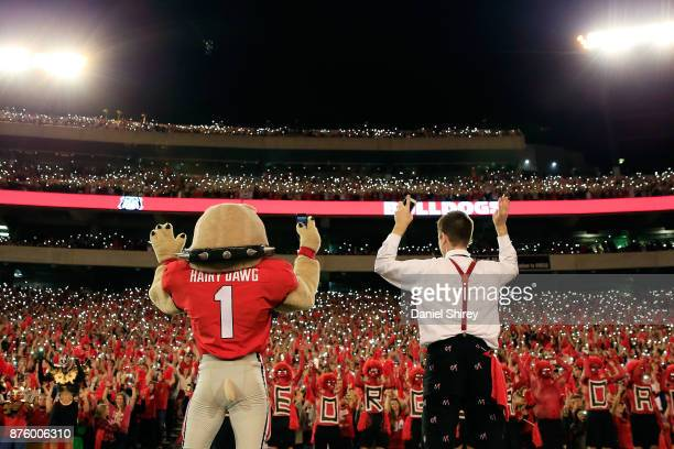 Hairy Dawg leads Georgia Bulldogs fans in the fourth quarter cheer during the second half against the Kentucky Wildcats at Sanford Stadium on...