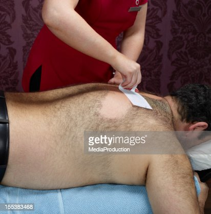 Hairy male back waxing