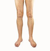 Studio shot of a young man legs with hair isolated on white background