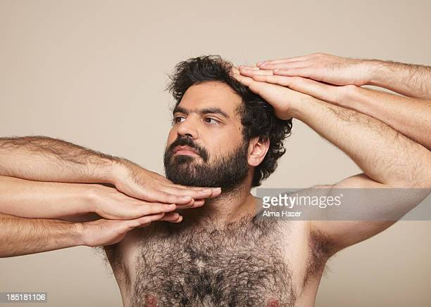 Hairy man with many hands in vogue pose