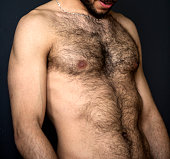 closeup of hairy naked upper body of a man