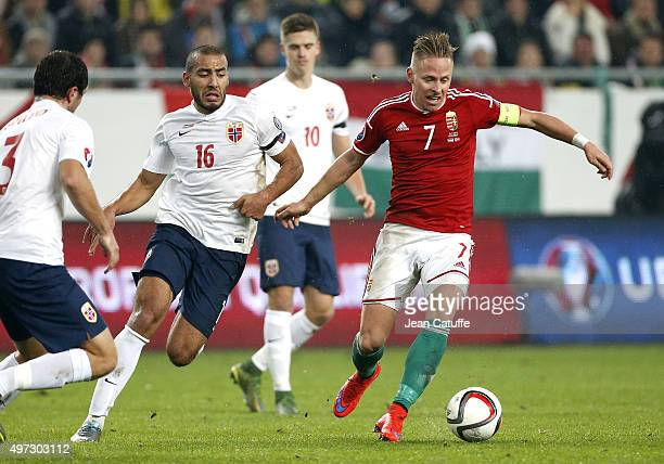 Haitam Aleesami of Norway and Balazs Dzsudzsak of Hungary in action during the UEFA EURO 2016 qualifier playoff second leg match between Hungary and...
