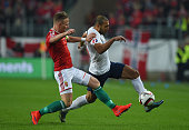 Haitam Aleesami of Norway is challenged Balazs Dzsuddzsak of Hungary during the UEFA EURO 2016 Qualifier PlayOff second leg match between Hungary and...