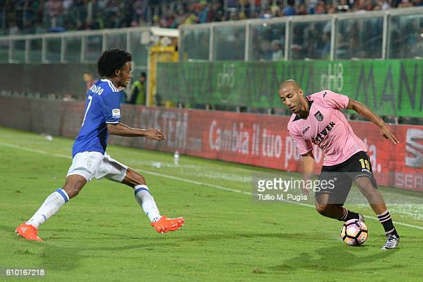 Haitam Aleesami of Palermo and Juan Cuadrado of Juventus compete for the ball during the Serie A match between US Citta di Palermo and Juventus FC at...