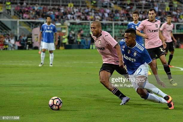Haitam Aleesami of Palermo and Lobo Silva Alex Sandro of Juventus compete for the ball during the Serie A match between US Citta di Palermo and...