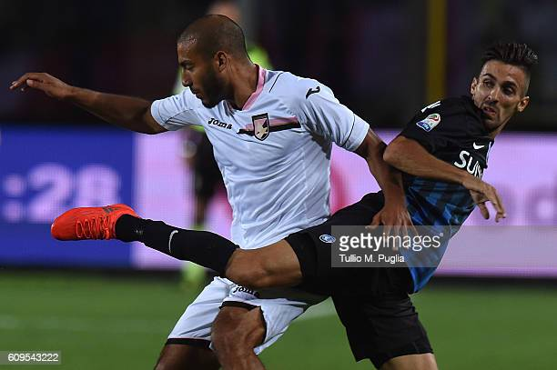 Haitam Aleesami of Palermo and Marco D'Alessandro of Atalanta in action during the Serie A match between Atalanta BC and US Citta di Palermo at...