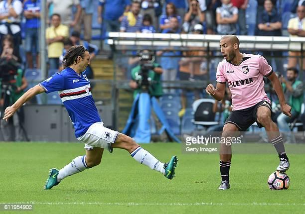 Haitam Aleesami of Palermo is challenged by Edgar Barreto of Sampdoria during the Serie A match between UC Sampdoria and US Citta di Palermo at...