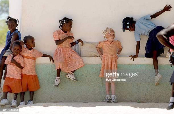 Haiti Isla de Laganave School children in uniform playing including an Albino girl
