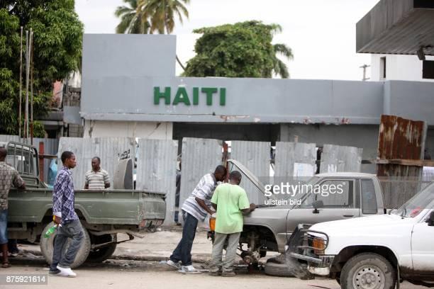 Haiti Ouest PortauPrince repairing a broken car on the road