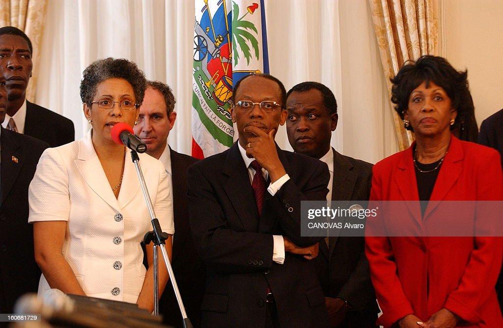 The President Aristide Threatened By Rebels. Les 'chimères', milices populaires au service du pouvoir, utilisées pour mater les opposants de Jean-Bertrand