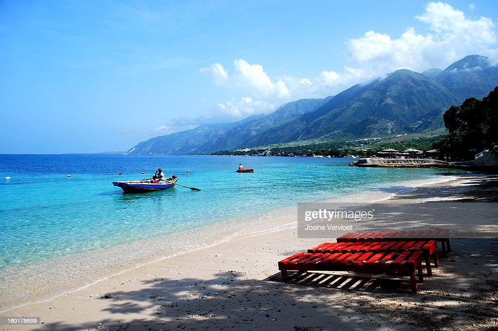 CONTENT] Haiti Wahoo Bay Blue Sky Skies Boat Ocean Calm Water Sea Caribbean Vacation Resort Beach Hotel Mountain View Sand Shadows Shore