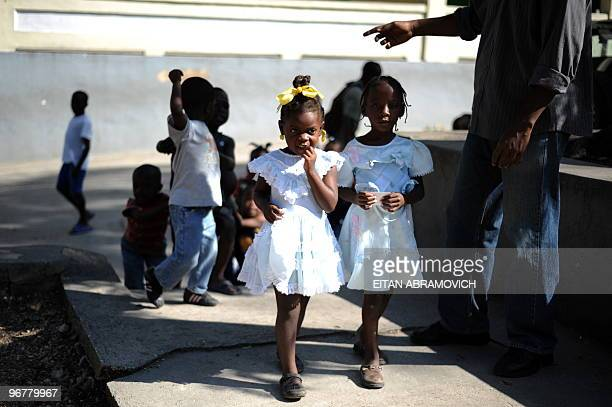 Haitian children make their way to a playground in the courtyard of a religious school in the heart of Petionville in the heights of the Haitian...