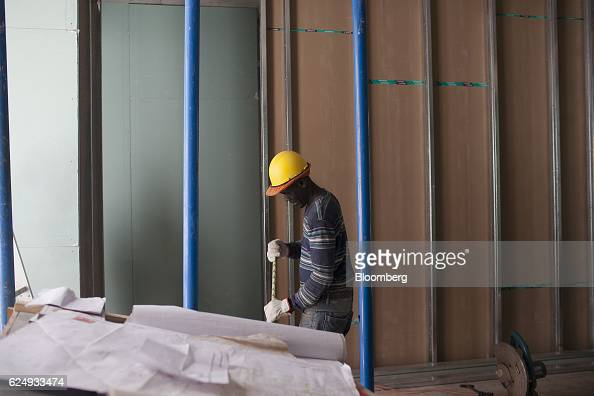 Haitian contractor Matial Estime works at a building under construction in Santiago Chile on Thursday Nov 10 2016 More than 34400 Haitians came to...
