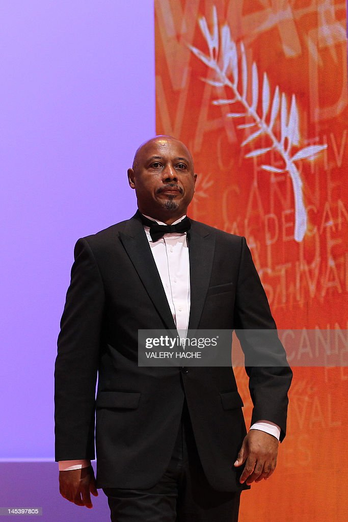 Haitian director and producer and member of the Jury Raoul Peck arrives on stage during the closing ceremony of the 65th Cannes film festival on May 27, 2012 in Cannes. AFP PHOTO / VALERY HACHE