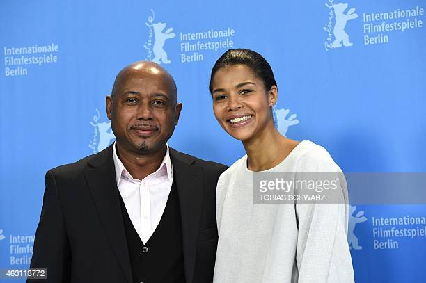 Haitian director Raoul Peck and NigerianGerman singer and actress Ayo pose for photographers at the photocall of the film 'Meutre a Pacot' presented...