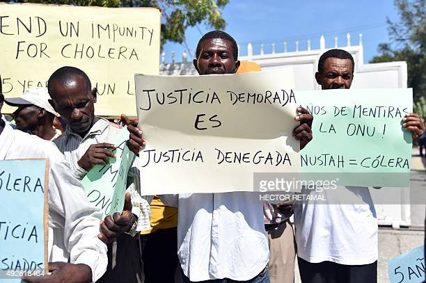 Haitian human rights and victims of cholera in Haiti rally in front of the Log Base of Minustah in PortauPrince on October 15 to demand justice and...