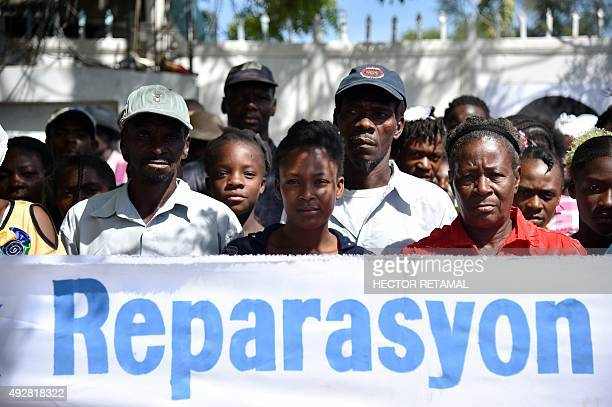 Haitian human rights and victims of Cholera protestors in Haiti rally in front of the Log Base of Minustah in PortauPrince on October 15 to demand...