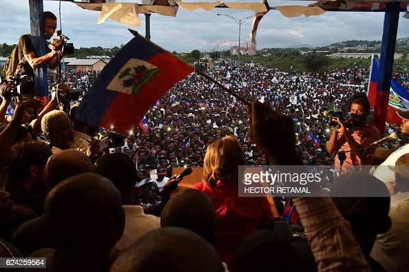 Haitian Lavalas Presidential candidate Marysse Narcisse speaks during a rally on the last day of electoral campaign in PortauPrince on November 18...