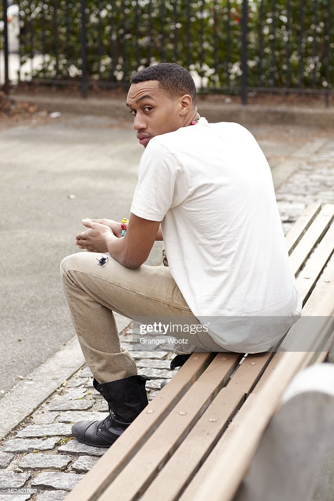 Haitian man sitting on bench