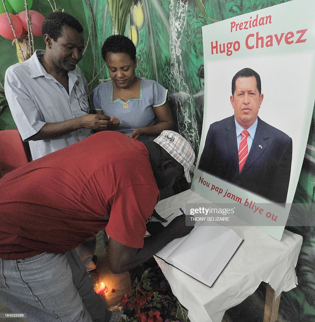 Haitian people sign a notebook in memory of the late president of Venezuela, Hogo Chavez during a meeting of the Peasant Movement of Papaye (MPP) on March 18, 2013 in Poet-Au-Prince, Hati. AFP PHOTO Thony BELIZAIRE