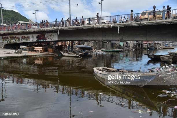 Haitian people walk on a bridge on Mapou River in Mapou River in CapHaitien in the north of Haiti 240 km from PortauPrince ahead of Hurricane Irma on...